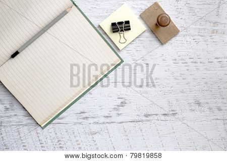 Notebook And Pencil On Textured Background
