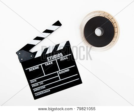 Clapper And 35Mm Reel Isolated