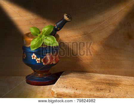 Old Wooden Mortar With Basil