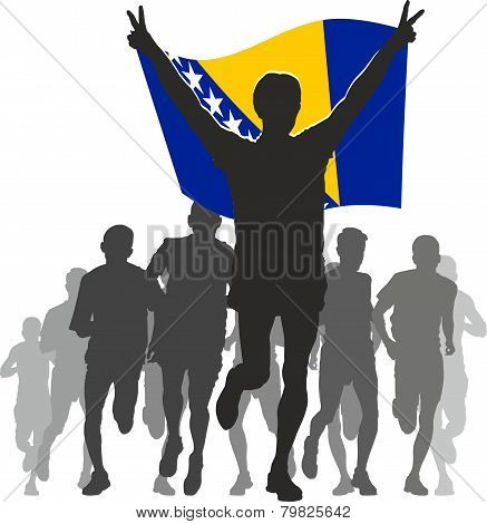 Athlete with the Bosnia and Herzegovina flag at the finish
