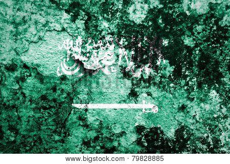 Saudi Arabia Flag on concrete wall.