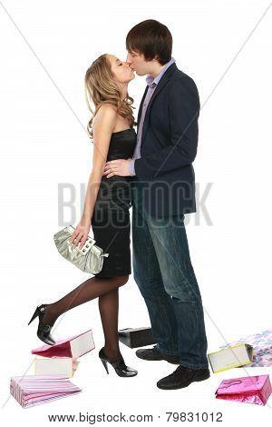 A girl kisses a fellow.