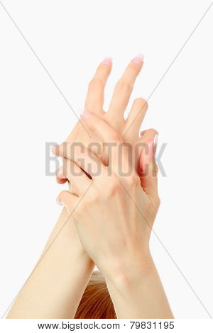 Beautiful woman hands with french manicure isolated on white background.