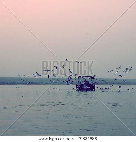 Fishing Boat At Ganga River Vintage Effect. Sunrise Retro Photo.