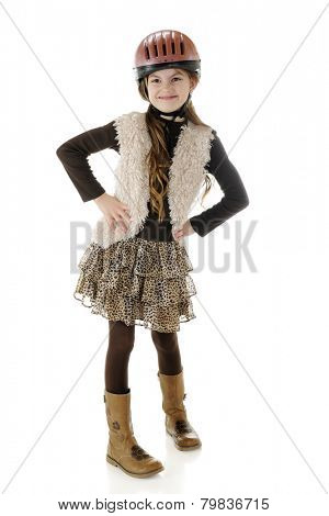 A full length portrait of a happy young horseback rider looking sassy in her riding helmet and boots.  On a white background.