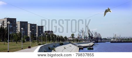 Houses And Harbour Cranes On The Embankment