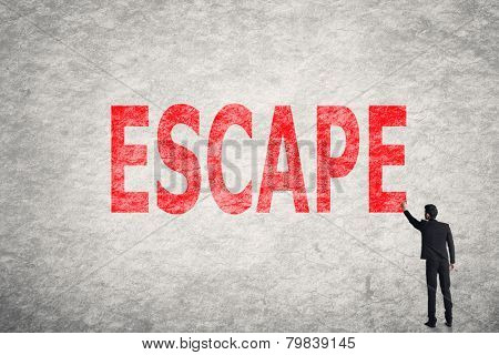 Asian businessman write text on wall, Escape