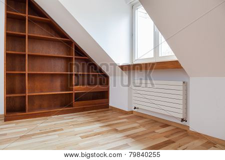 Empty Bookshelf In The Attic