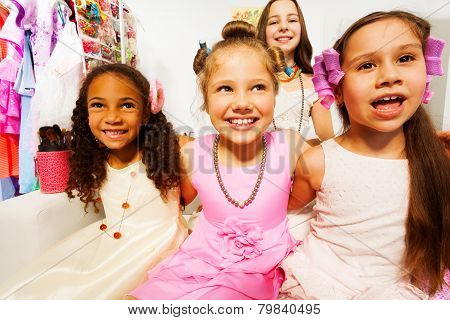 Close-up view of beautiful girls with hair-curlers