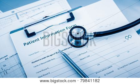 Stethoscope on patient form on the desk.