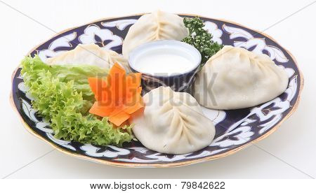 Dumplings Submitted With Leaves Of Fresh Salad, Sour Cream And Carrots.