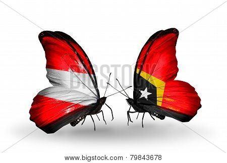 Two Butterflies With Flags On Wings As Symbol Of Relations Austria And East Timor