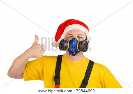 Worker in xmas hat with respirator.