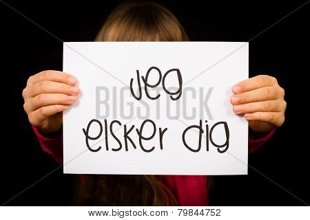 Child Holding Sign With Danish Words Jeg Elsker Dig - I Love You