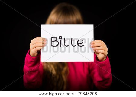 Child Holding Sign With German Word Bitte - Please
