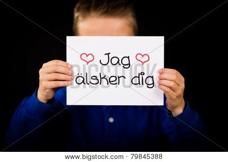 Child Holding Sign With Swedish Words Jag Alsker Dig - I Love You