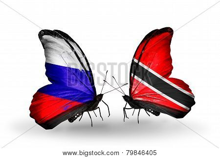 Two Butterflies With Flags On Wings As Symbol Of Relations Russia And Trinidad And Tobago