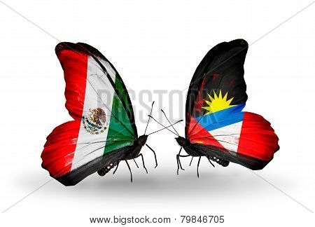 Two Butterflies With Flags On Wings As Symbol Of Relations Mexico And Antigua And Barbuda