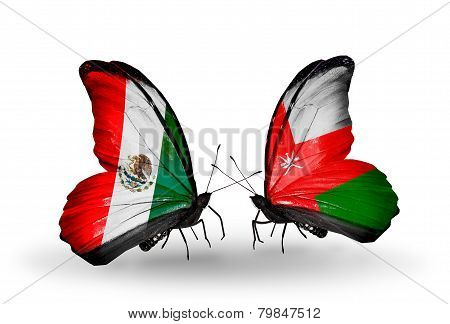 Two Butterflies With Flags On Wings As Symbol Of Relations Mexico And Oman