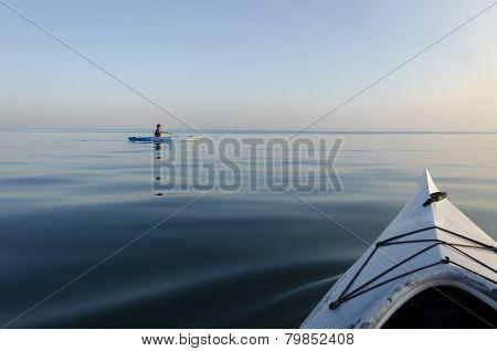 Woman Kayaking On The Lake