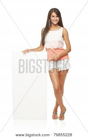 Woman showing blank copy space