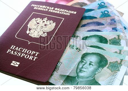 Russian Travel Passport With Chinese Banknotes