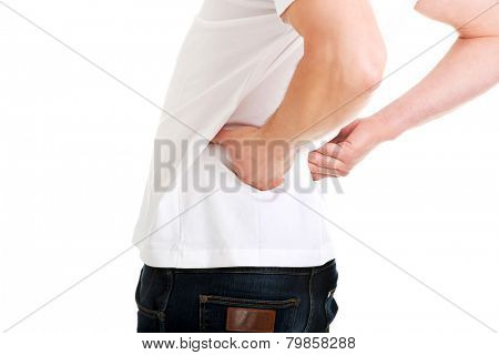 Young man in agony with back pain