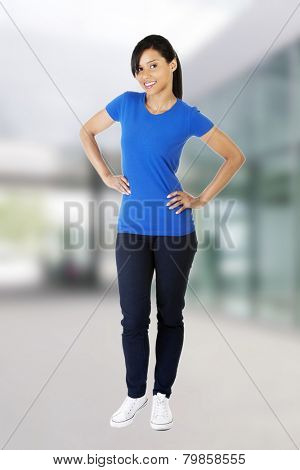 Happy woman posing in blue shirt