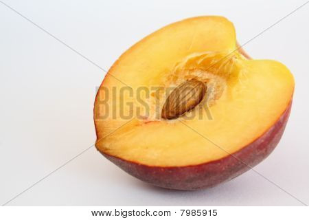 Half Of Velvety Peach With Open Seed