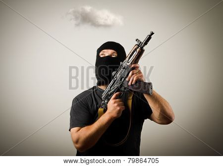 Man With Gun And Cloud.
