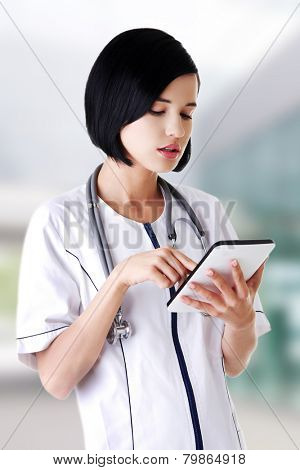 Young female doctor with a tablet