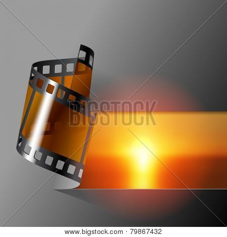 Curled photo film strip with sea sunset background. Movies and Photo album cover.