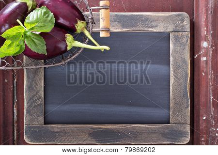 Chalkboard with vegetables on the side