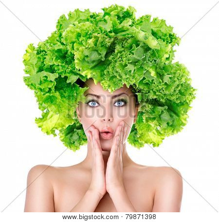 Surprised model girl with Lettuce hair style. Beautiful happy young woman with green vegetables on her head. Healthy food concept, diet, vegetarian food. Dieting concept. Weight loss. Vegan food