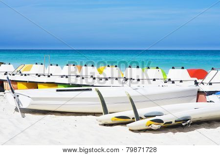 Colorful Pedalos Docked At The Shore Of The Tropical Beach Of Santa Maria In Cuba