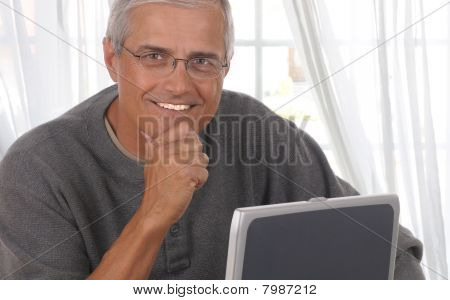 Man In Living Room With Computer