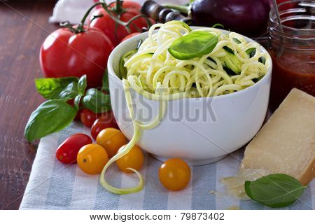 Zucchini noodles in a bowl with fresh vegetables