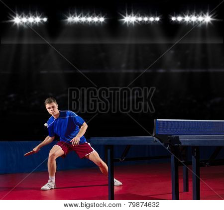 Young table tennis player at sport hall