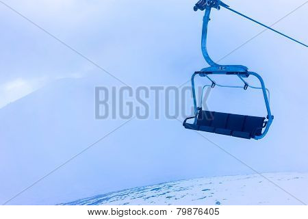 Empty Ski Lift Over The Snowed Mountain