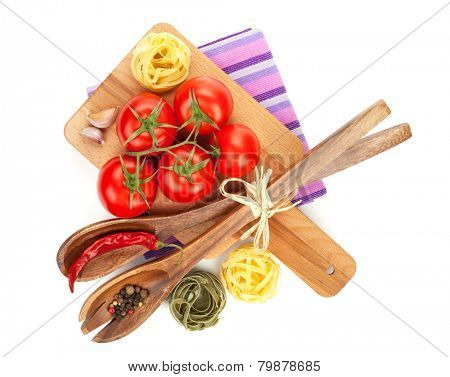Pasta, tomatoes and spices. Isolated on white background