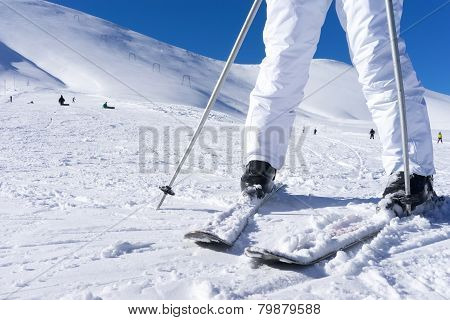 Close Up Of A Skier's Feet With Ski Poles.