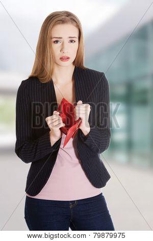 Sad woman with empty purse
