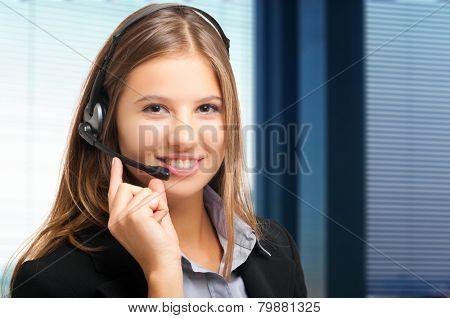 Smiling female call center operator portrait