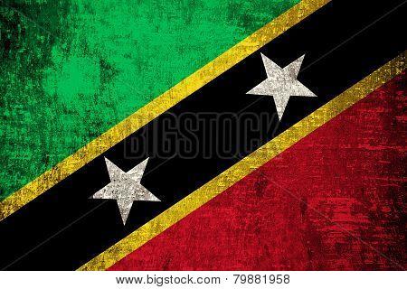 Saint Kitts and Nevis Flag painted on old wood texture