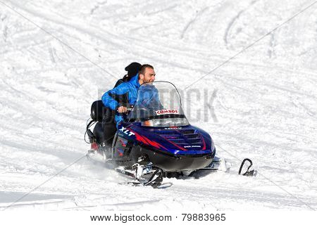 Visitors Enjoy The Snow On Snowmobiles In Falakro Ski Center, Greece. The Ski Resort Of Falakro Moun