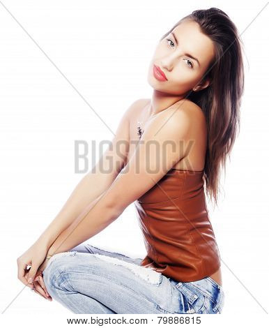 girl with tattered jeans sit on floor
