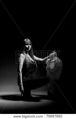 Woman holding dummy
