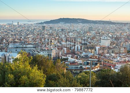 BARCELONA, SPAIN - DEC 25, 2014: Top view of Barcelona from park Guel on sunset. Barcelona is capital city of Catalonia in Spain and the country's 2nd largest city, with a population of 1.6 million.