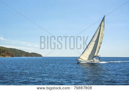 Sailing ship yachts. Shores of the Aegean Sea. Cruise sailing.