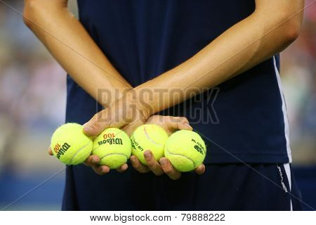 Ball boy holding tennis balls at the Billie Jean King National Tennis Center during US Open 2014
